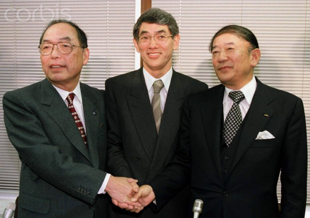 23 Jan 1997 --- Sega Enterprises Ltd chairman Isao Okawa (L) and its president Hayao Nakayama (R) shake hands with Makoto Yamashina, president of Bandai Co Ltd, at a conference room of Tokyo Stock Exchange January 23 after announcing their merger. Sega, a leading producer of video games for both the home and arcade market, and Bandai, a leading Japanese toy producer, said today they will merge October 1, creating a formidable new world force in the toy and videogame market. - RTXHPZS --- Image by © © Kimimasa Mayama / Reuters/Reuters/Corbis